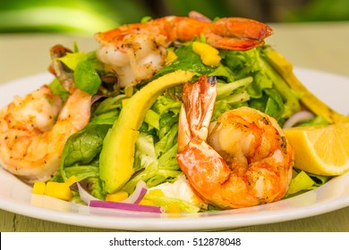 Italian prawn salad with mango, purple onion and avocado