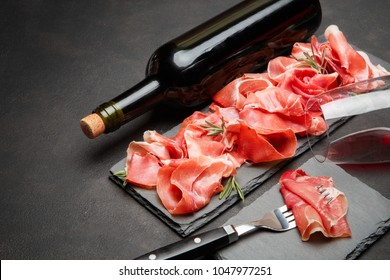 Italian prosciutto crudo or spanish jamon anw glass of wine