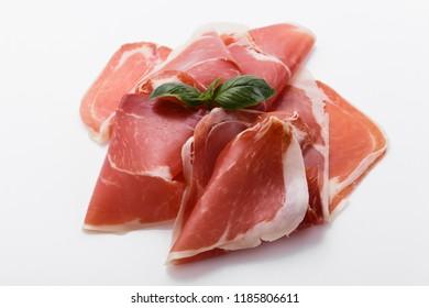Italian prosciutto crudo or spanish jamon on a white background