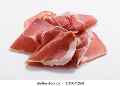 Italian prosciutto crudo or spanish jamon on a white background