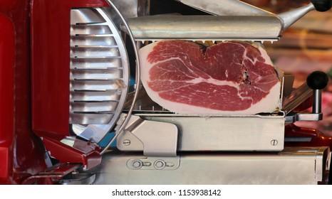 Italian prosciutto inside slicer machine sold on market