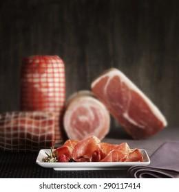 Italian prosciutto, pancetta, coppa on wooden board