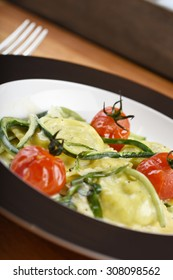 Italian ravioli filled with courgette and ricotta, served with oven baked cherry tomatoes and a cream sauce