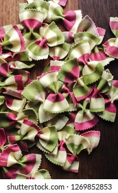 Italian raw multicolored farfalle pasta. View from above