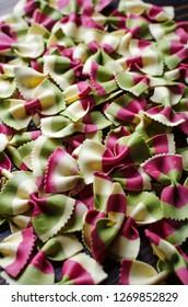 Italian raw multicolored farfalle pasta.Close up