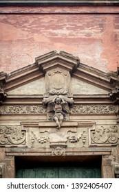 Italian renaissance door frame. Embelished entrace. Flourish motif.
