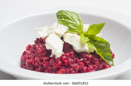 Italian risotto with beetroot and ricotta cheese