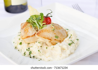 Italian risotto with chicken and white wine in a restaurant.