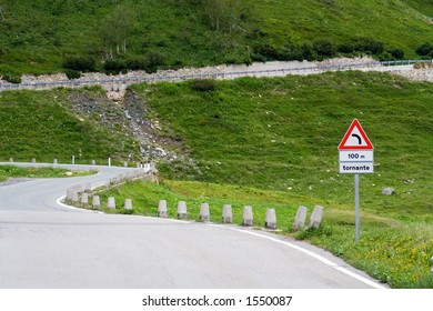 Italian road sign on a mountain road in the Alps