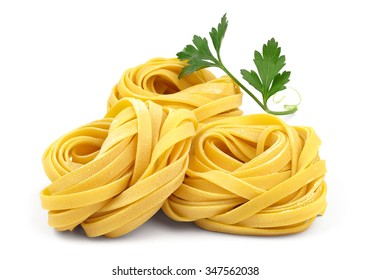 Italian rolled fresh fettuccine pasta with flour and parsley isolated on white background.