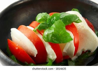 Italian salad with tomato, mozzarella and basil