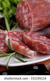 Italian salami sliced �¢??�¢??on wooden table