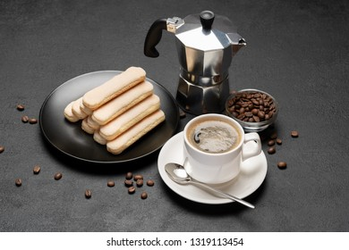 Italian Savoiardi ladyfingers Biscuits and cup of coffee on concrete backgound