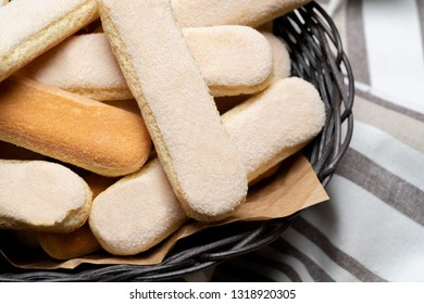 Italian Savoiardi ladyfingers Biscuits on wooden backgound with copy space