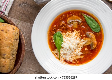 Italian soup with tomatoes, mushrooms, minced meat, cheese, vegetables, delicious dish