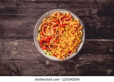 Italian Spaghetti in a bowl with cheddar cheese