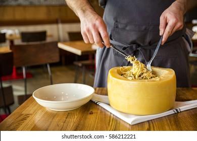 Italian Spaghetti Pasta Cooked inside a giant Parmesan Cheese Wheel