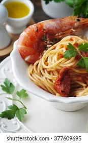 Italian spaghetti with prawns and parsley, selective focus