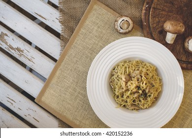 Italian specialty pasta with mushrooms - pasta con funghi top view