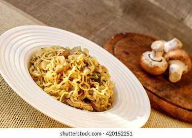 Italian specialty pasta with mushrooms - pasta con funghi close up, selective focus