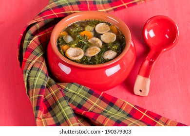 Italian spicy soup with sausages and kale