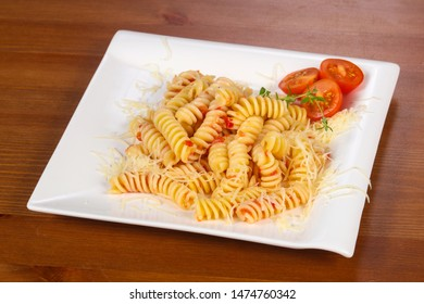 Italian springs pasta with tomato sauce and cheese