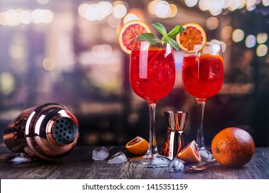 Italian Spritz cocktail with orange slices on a bar counter. Summer sangria or red cocktail with ingredients
