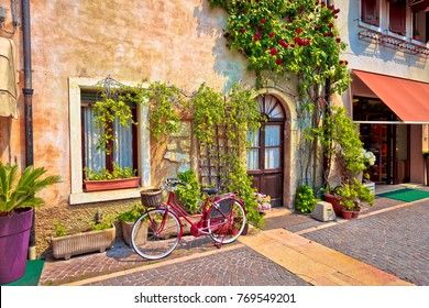 Italian street old architecture in Lazise, town on Garda lake in Veneto region of Italy