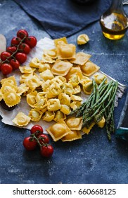 Italian stuffed pasta, tortellini, ravioli with cherry tomatoes.