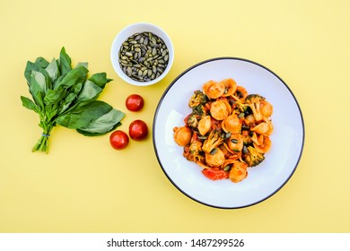 Italian Style Broccoli Orecchiette Pasta Vegetarian Meal With Sundried Tomatoes and Black Olives