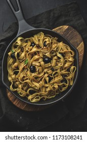 Italian style pasta dinner. Pasta with herbs and olives