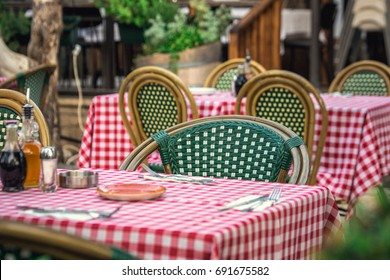 Italian style restaurant with square tablecloths at Tel Aviv, Israel.