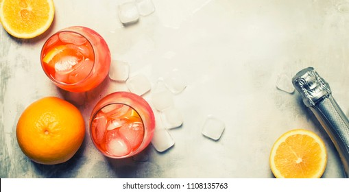 Italian Summer Cocktail With Aperitif Named Aperol Spritz With Bitter, Ice, Sparkling Wine And Orange Slice, Top View