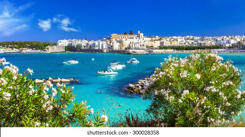 Italian summer holidays- Otranto town in Puglia with crystal turquoise waters