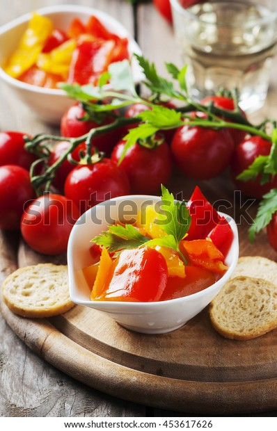 Italian sweet-sour paprika with bread and tomato, selective focus