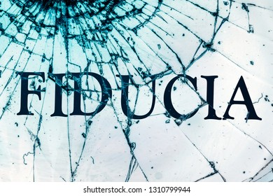 """The Italian text """"Trust"""" on the broken glass. The deceived trust concept."""