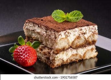 italian tiramisu with cocoa, mint and  strawberry