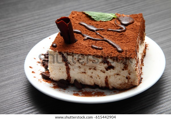 Italian tiramisu dessert/ tiramisu dessert on a porcelain plate