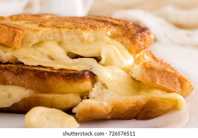 Italian toast sandwich with white bread and mozzarella cheese fried in oil. Mediterranean meal. Close up.