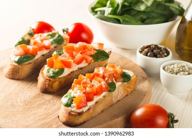 Italian tomato and cheese bruschetta. Tapas, antipasti with chopped vegetables, herbs and oil on grilled ciabatta and baguette bread. italian, table, green, antipasti, Italy, diet, brown, snack, toast
