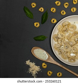 Italian Tortellini Pasta with Alfredo Sauce and Basil. Selective focus.