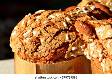 """Italian traditional cake for Easter called """"Colomba"""" with icing sugar and almonds."""