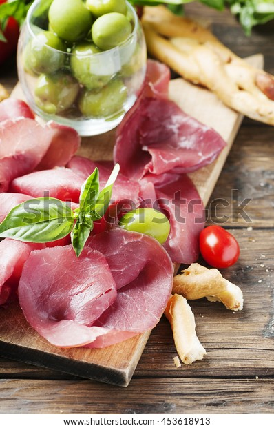 Italian traditional carpaccio of beef, selective focus