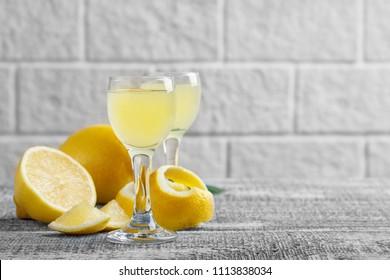 Italian traditional liqueur limoncello with lemon