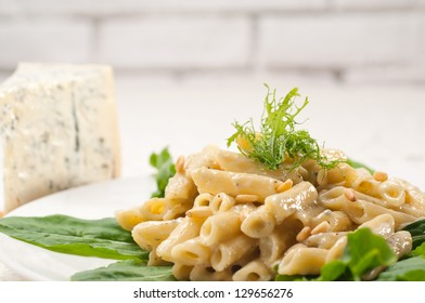 Italian traditional pasta penne gorgonzola and pine nuts