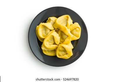 Italian traditional tortellini pasta on plate isolated on white background.