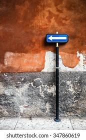 Italian traffic sign and orange wall.