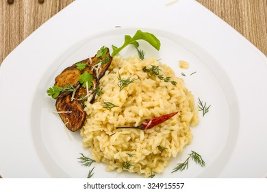 Italian trditional Risotto with eggplant and coriander