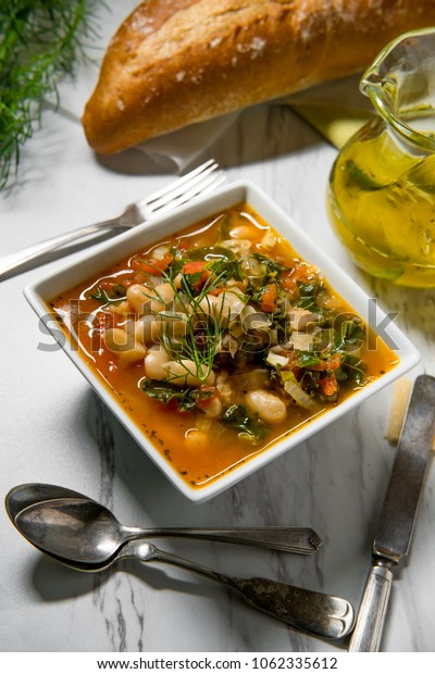 Italian Tuscan Ribollita bread and cannellini bean peasant soup with fennel