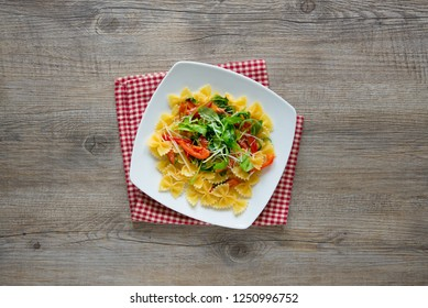 italian type pasta called farfalle butterflies and little tomatoes